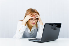 Weary worker in the office Stock Photography