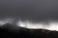 Weather. Rainy clouds over the hills Royalty Free Stock Photography