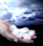 Weather anomaly hail in hand. S and lightning Royalty Free Stock Images