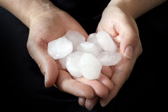Weather anomaly hail in hands stock image