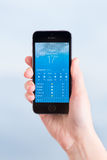 Weather application on Apple iPhone 5S Stock Images
