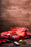 Weather backpack, sunglasses and gear for the bicycle on the wooden background. Stock Photo