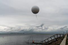 Weather balloon flies on the sea near the haven of Aarhus.  stock image