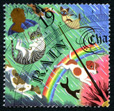 Weather Barometer UK Postage Stamp. GREAT BRITAIN - CIRCA 2001: A used postage stamp from the UK, depicting an illustration of a weather barometer showing rain Stock Image