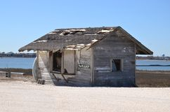 Weather beaten shack or house by the water Stock Photo