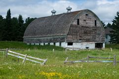 Weather beaten white barn Stock Photo