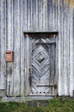 Weather-beaten wooden door and wall Stock Photo