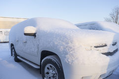 Weather. Car at parking lot covered with snow Stock Photos