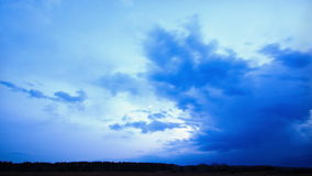 The weather is changing at sunset. Time Lapse. 4K Royalty Free Stock Image