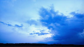 The weather is changing at sunset. Time Lapse Royalty Free Stock Photos