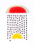 Weather concept, watermelon and orange shape of rainy season. pa Royalty Free Stock Photography