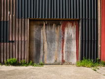Weather door in wall of corrugated sheets Royalty Free Stock Photos
