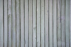Weather fence texture. A background of smooth fencing with strips, nail holes and knots Royalty Free Stock Photos