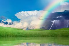 Weather forecast concept with colorful rainbow and lightnings Stock Image