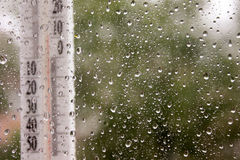 Weather forecast rain. Photo for your design. Thermometer Royalty Free Stock Photo