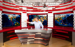 Weather forecast. A television anchorman at studio Royalty Free Stock Photo