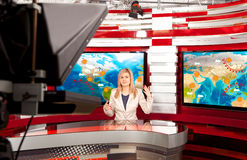 Weather forecast. A television anchorwoman at studio Stock Photography