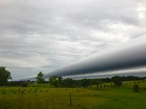 Shelf Cloud Formation. A weather front shelf cloud moving in royalty free stock photo