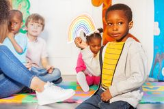Weather game in the nursery class and boy portrait royalty free stock photography
