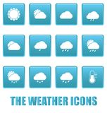 Weather icons on blue squares Royalty Free Stock Photography