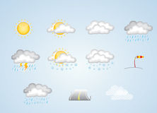 Weather icons - sunny, cloudy, rain, snow and more. Weather icons for spring, summer, autumn and winter on blue background Stock Photo