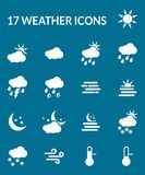 Weather icons. 17 white symbols on blue background representing weather situations Stock Photo