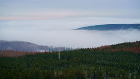 Late autumn with incoming fog and a pastel-colored sky in the Harz mountains, northern central Germany. royalty free stock images