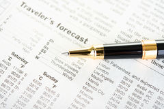 Weather in Newspaper with Pen Stock Photography