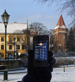 Weather Report - iphone 4s - Krakow - Poland. Using a weather app to get a local weather report on an iPhone 4s. Winter temperatures in the Planty, the largest Stock Image