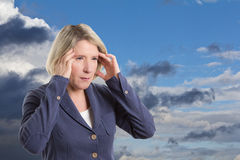Weather sensitive woman with headache Stock Photos