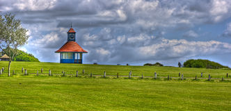 Weather Shelter Frinton. Weather Shelter and Clock Tower at Frinton-on-Sea royalty free stock photo