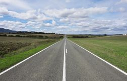 Weather, sky with clouds and straight road Stock Photography