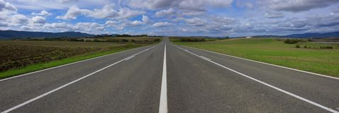Weather, sky with clouds and straight road. To infinity, Alava, Basque Country Stock Photography