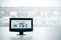 Weather station device with weather conditions outside backgroun Royalty Free Stock Photo
