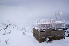 Weather station in the mountains. Weather station on a snowy mountain top royalty free stock photography