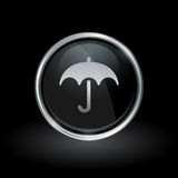 Weather umbrella icon inside round silver and black emblem Royalty Free Stock Photos