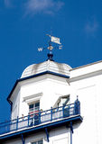 Weather vane. An image of a weather vane on top of the roof of a building stock photos