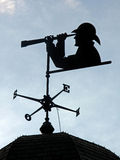Weather Vane. A weather vane with person looking through a telescope Royalty Free Stock Image
