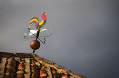 Weather vane. Colorful weather vane with figure over cloudy sky stock photography