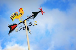 Weather vane. Colorful weather vane with figure over cloudy sky royalty free stock photography