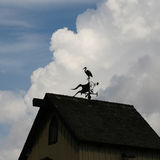 Weather vane. A weather vane in the beautiful sky background stock photography
