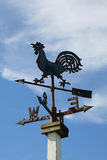 Weather Vane. Rusty old iron weather vane. Focus on cockerel on top royalty free stock photography