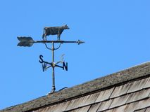 Weather Vane. Cow weather vane. Heritage Park, Calgary, Alberta, Canada stock photos