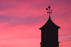 Weather Vane. Against a colorful sunset sky royalty free stock photos