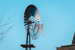 Weather vane blowing in the wind at the Michigan farm garden at the Frederik Meijer Gardens. In Grand Rapids Michigan royalty free stock image