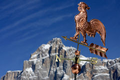 Weather vane in the blue sky Stock Images