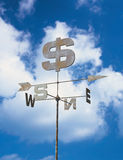Weather vane with dollar symbol. Financial weather vane which shows dollars royalty free stock photography