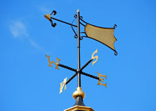 Weather vane on blue sky Royalty Free Stock Photos