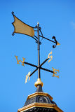 Weather vane on blue sky Royalty Free Stock Images
