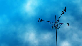 Weather Vane Change Loop. High definition animated loop of a weather vane blowing in the wind. As the clouds take a stormy turn midway through the vane switches stock footage